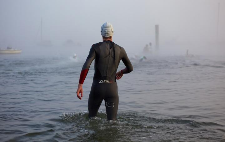 Rear photo of a man wearing a Zone3 wetsuit