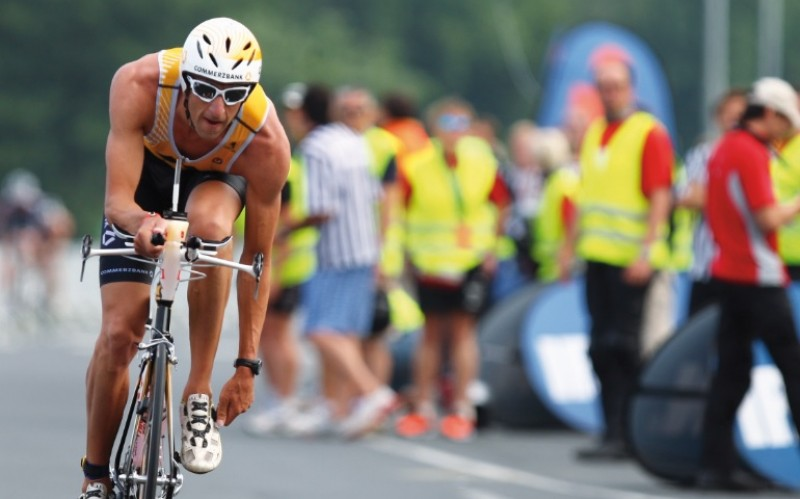 image of triathlete racing