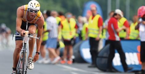 image of triathlete racing