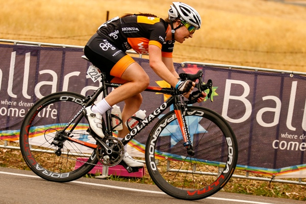 A cyclist in Wiggle Honda branded kit in action